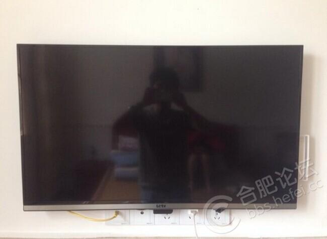 電視機掛在墻上更美觀一點